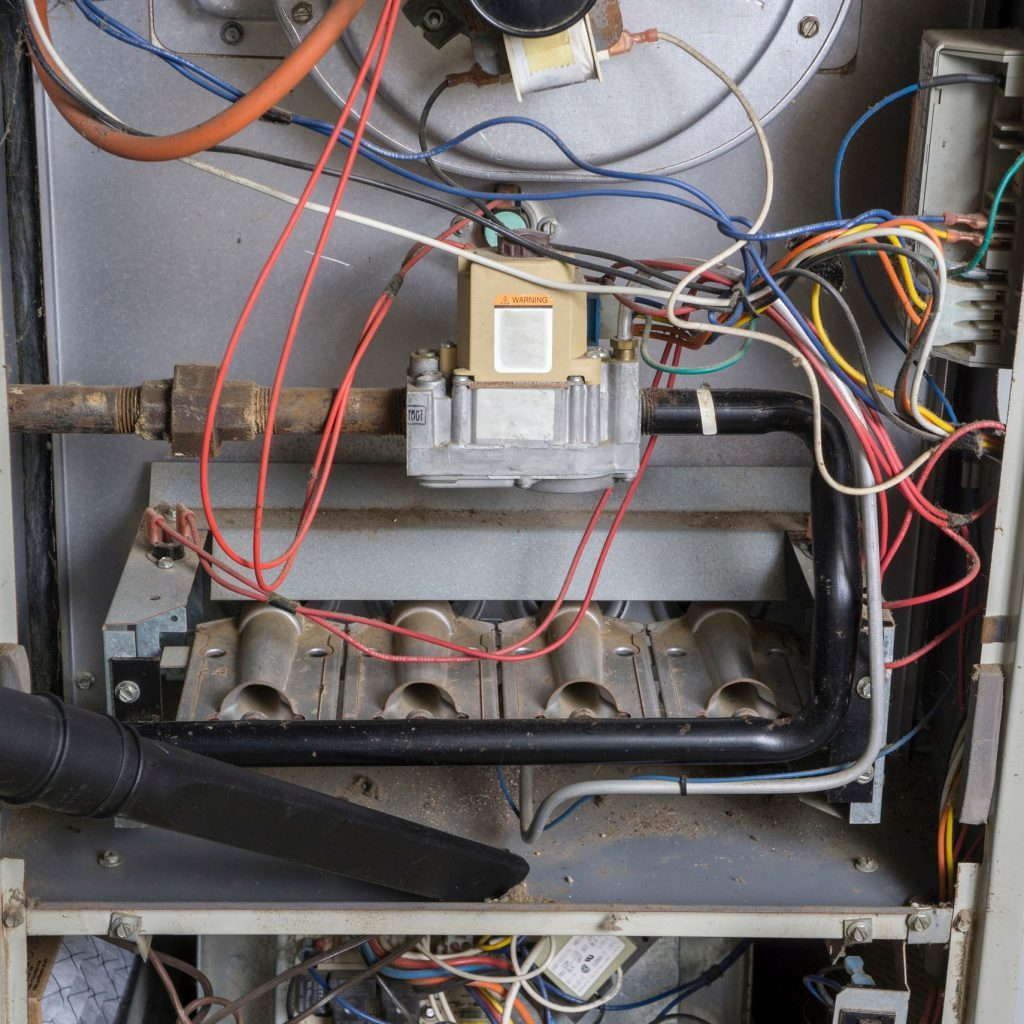 The inside of a furnace in need of repair